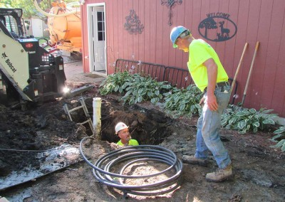 After digging the trench our technicians connect the well pump to the pressure tank using waterline.