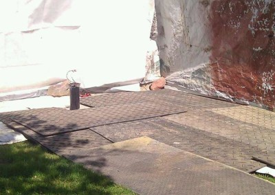 Matting in to prevent damage to landscaping before setting up to drill deeper in an existing rock well